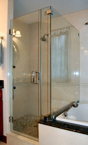 Frameless corner shower using glass clamps