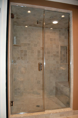 Frameless steam shower, wall mounted hinges, done in Warren, NJ