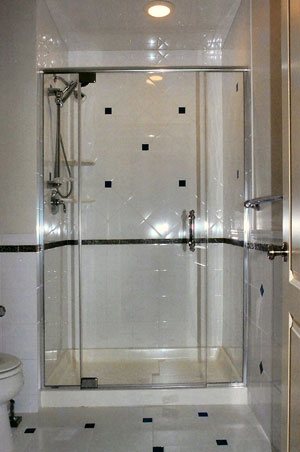 Frameless shower enclosure with header using Starphire glass